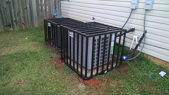 two air conditioners hvac compressor cage enclousure