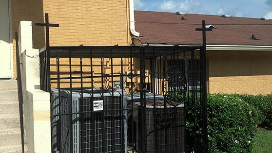 Church wrought iron fence air conditioner